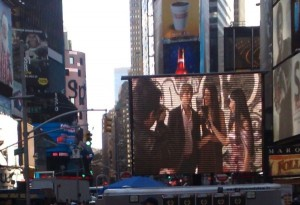 "Damian Nixey, Marc Petzke, Shailla Quadra and Yolandi Franken, still image of ""Brad Fitt Will Be Mine"" showing in the heart of Times Square at the New York City International Film Festival."